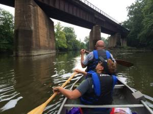 Dave and Joanne Sura of Girard paddle under a railroad trestle on their way from Girard to Youngstown
